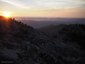 A purple, peach, and orange Sunrise from the summit