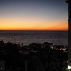 A sunny bar of orange in the Western skys looking from a rooftop in old town in Puerto Vallarta