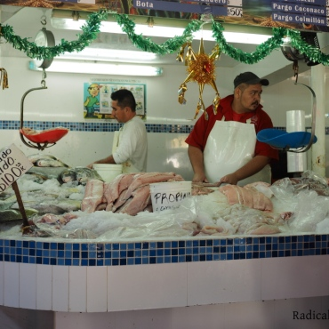Fishmongers hard at work, at Jorge's fish market of choice.