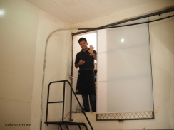 Jorge Jr. Hernandez, waves from the storage pantry, as he completes the days digital inventory.