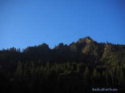 Sunrise on the canyon walls, with the moon